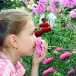 Girl smelling flowers — Stock Photo #6690079