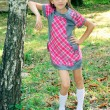 Stockfoto: Girl standing near tree
