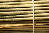 Stacks of newspapers background — Stock Photo