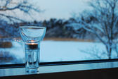 Candle on a window-sill — Stock Photo