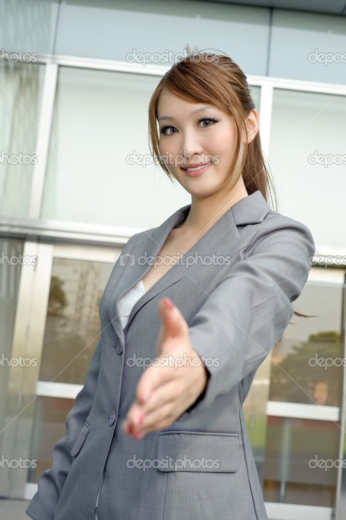 Young business manager shaking hand with you, half length closeup portrait outside of modern buildings. — Stock Photo #5494337