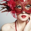 The beautiful young woman in a red venetian mask — Stock Photo #5389034