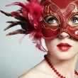 The beautiful young woman in a red venetian mask — Stock Photo #5389037