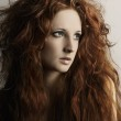 Fashion portrait of a young beautiful redheaded woman — Stock Photo #5389048