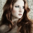 Fashion portrait of a young beautiful redheaded woman — Stock Photo #5389071