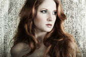 Fashion portrait of a young beautiful redheaded woman — Stock Photo