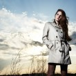 Fashion portrait of elegant woman in a raincoat — Stock Photo
