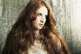Fashion portrait of a young beautiful redheaded woman — Stockfoto