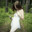 Portrait of romantic woman at fairy forest — Stock Photo