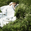 Portrait of the sleeping young woman on a meadow — Stock Photo