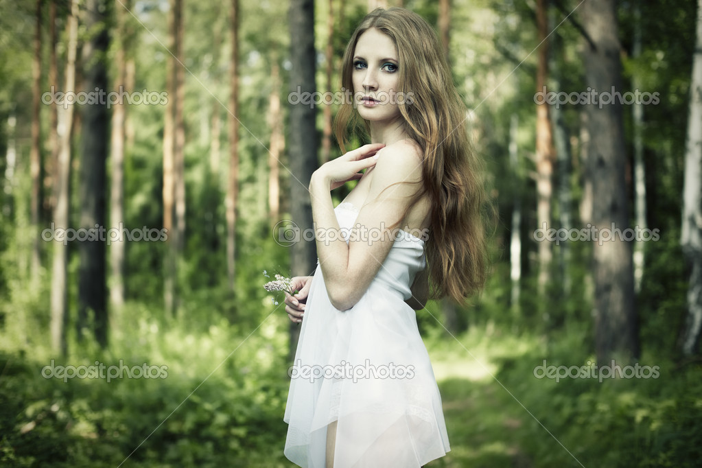 Portrait of romantic woman at fairy forest. Shooting on the nature — Stock Photo #6039911