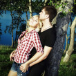 Portrait of love couple embracing outdoor in park — Stok fotoğraf