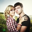 Portrait of love couple embracing outdoor in park — Stock Photo #6278679