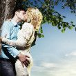 Portrait of love couple embracing outdoor in park — Stock Photo