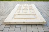 Wooden door made of coniferous tree — Stock Photo