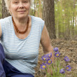 Stock Photo: Elderly womin forest springtime