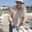Bricklayer builds a wall — Stock Photo