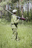 The shooter in camouflage — Stock Photo
