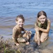 Children in mud on river — Stock Photo #6271064