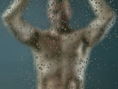 Man in shower — Stock Photo