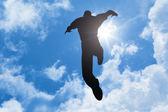 Bright sun man jumping — Stock Photo
