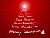 Merry christmas in different languages — Stock Photo