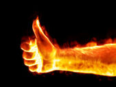 Thumb up on fire — Stock Photo