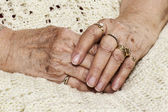 Senior woman's crossed hands — Stock Photo