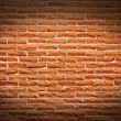 Terra cotta brick wall background - Stock Photo