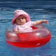 Baby girl in plastic boat — Stock Photo