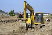 Yellow digger at big job site — Stock Photo