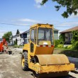 Asphalt roller on gravel — Stock Photo