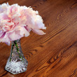Peony flowers on wooden table — Stock Photo