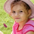 Cute little girl holding flower - Stock Photo