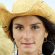 Portrait of cowgirl with hint of smile — Stock Photo #6593080