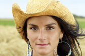 Portrait of cowgirl with hint of a smile — Stock Photo