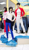 Plastic mannequins in clothes store — Stock Photo