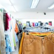 Stock Photo: Rack with clothes