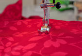 Sewing machine and cloth — Stock Photo