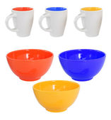Three multicolored mugs and bowls — Stock Photo
