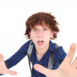 Funny looking man reching to grab the camera — Stock Photo