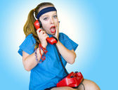 Eighties style teen girl talking on the phone — ストック写真