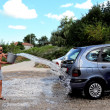 Young man washing the car — Stock Photo