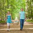 Two teenagers going to picnic - Stock Photo