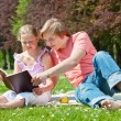 Teenager siblings reading book — Stock Photo