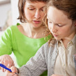 Girl doing prework with her mom — Stock Photo #5908978