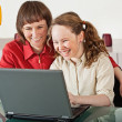 Mom and daughter with laptop — Stock Photo