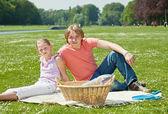 Two teenager siblings at picnic — Stock Photo