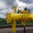 Yellow pipes and valve - Foto Stock