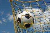 Foot ball in mesh — Stock Photo